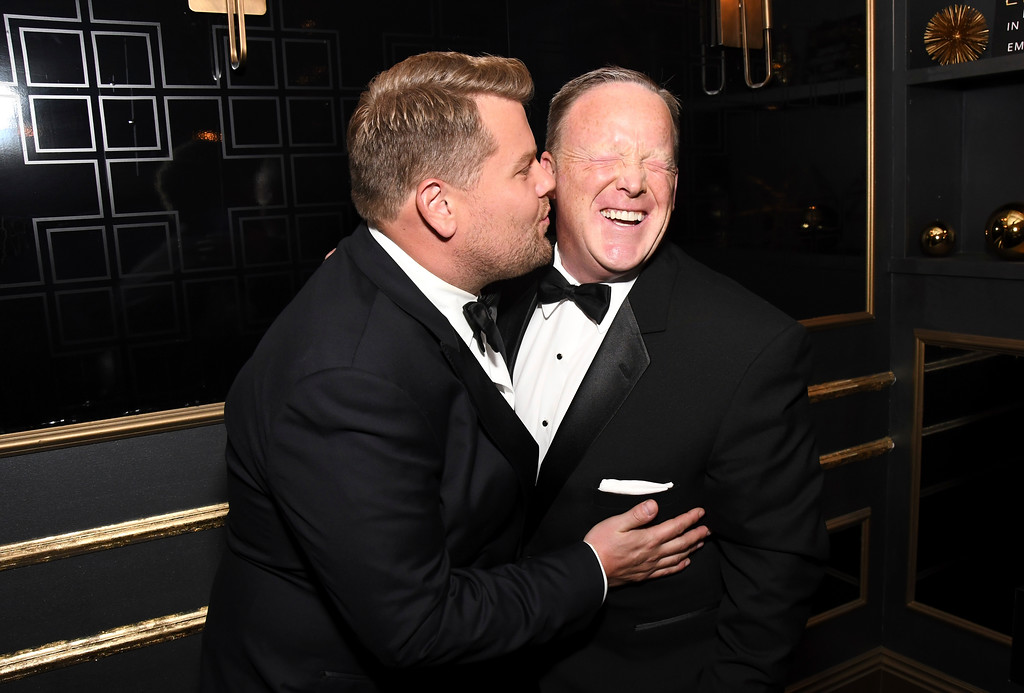 . EXCLUSIVE - James Corden, left, kisses Sean Spicer in the green room at the 69th Primetime Emmy Awards on Sunday, Sept. 17, 2017, at the Microsoft Theater in Los Angeles. (Photo by Charles Sykes/Invision for the Television Academy/AP Images)