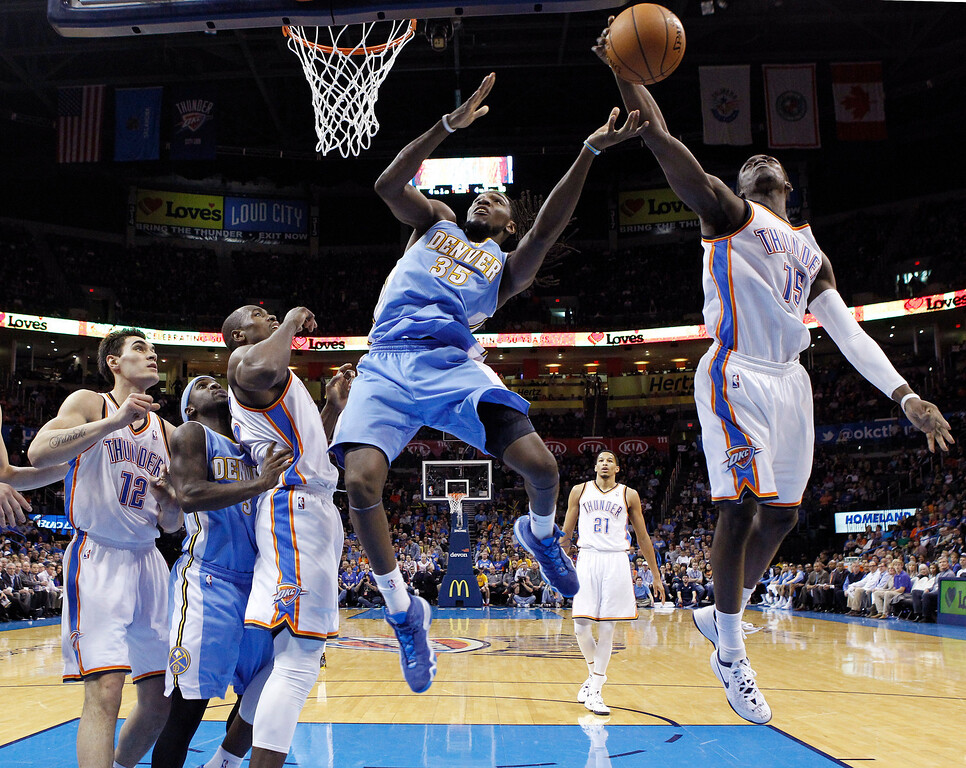 . Oklahoma City Thunder guard Reggie Jackson (15) blocks a shot by Denver Nuggets forward Kenneth Faried (35) in the third quarter of an NBA basketball game in Oklahoma City, Monday, March 24, 2014. Oklahoma City won 117-96. (AP Photo/Sue Ogrocki)