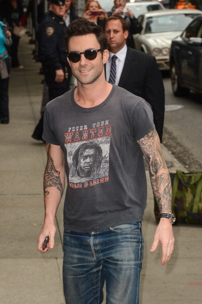 ". NEW YORK, NY - OCTOBER 25:  Singer Adam Levine enters the ""Late Show With David Letterman\"" taping at the Ed Sullivan Theater on October 25, 2012 in New York City.  (Photo by Ray Tamarra/FilmMagic)"
