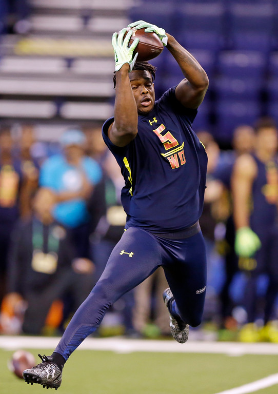 . Ohio State wide receiver Noah Brown makes a catch as he run a drill at the NFL football scouting combine in Indianapolis, Saturday, March 4, 2017. (AP Photo/Michael Conroy)