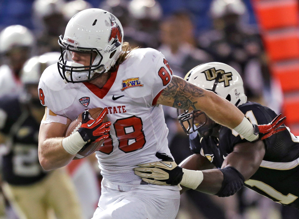 . Ball State tight end Zane Fakes (88) pushes off Central Florida linebacker Terrance Plummer after a reception during the second quarter of the Beef \'O\' Brady\'s Bowl NCAA college football game Friday, Dec. 21, 2012, in St Petersburg, Fla. (AP Photo/Chris O\'Meara)