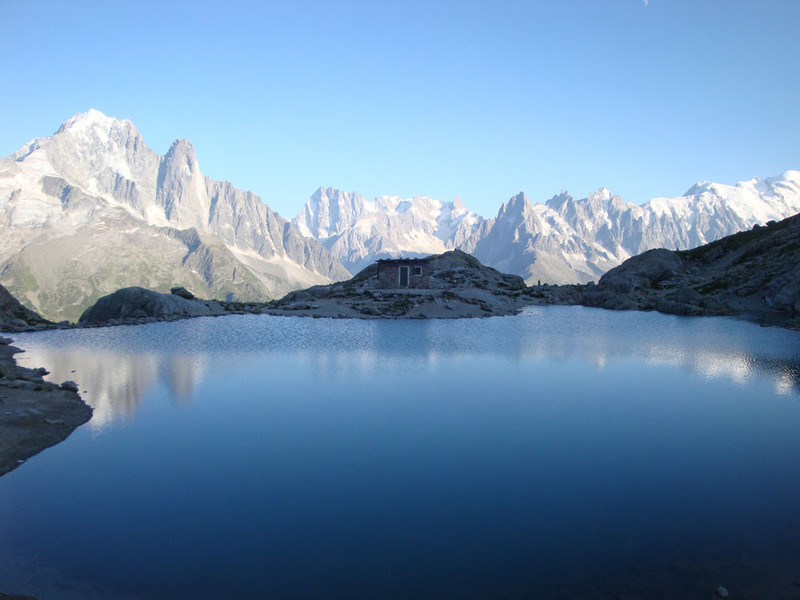 The original hut is visible in the middle, on the shore of Lac Blanc. The new 2-story hut is off-shot to the left. It has a restuarant and you can stay there.