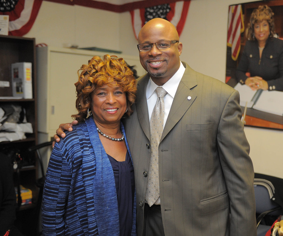 . an Hiller)- Carson Councilwoman Lula Davis-Holmes enjoys the atmosphere at her election night campaign headquarters as she and Mayor Jim Dear were in a tight race for mayor late Tuesday night in Carson. she poses for a picture with Long Beach City Councilman Al Austin.