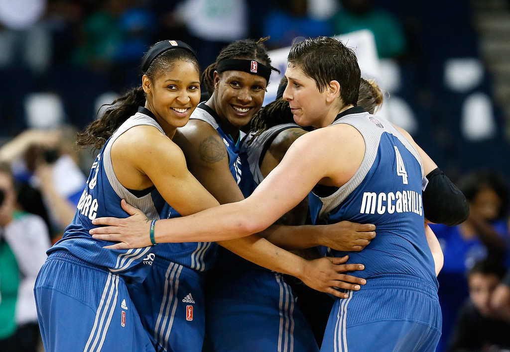 . ATLANTA, GA - OCTOBER 10:  Maya Moore #23, Rebekkah Brunson #32, Seimone Augustus #33, Lindsay Whalen #13, and Janel McCarville #4 of the Minnesota Lynx celebrate in the final seconds of their 86-77 win over the Atlanta Dream during Game Three of the 2013 WNBA Finals at Philips Arena on October 10, 2013 in Atlanta, Georgia.  (Photo by Kevin C. Cox/Getty Images)