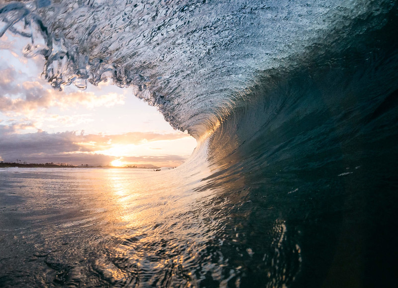 sunset breaking wave byron.jpg