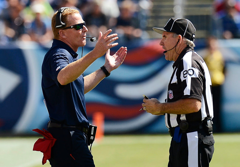 . Dallas Cowboys coach Jason Garrett argues with field judge Greg Gautreaux (80) in the fourth quarter of an NFL football game against the Tennessee Titans on Sunday, Sept. 14, 2014, in Nashville, Tenn. (AP Photo/Mark Zaleski)