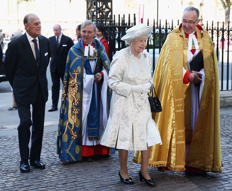 . Queen Elizabeth II arrives with Prince Philip, Duke of Edinburgh (L) and Dean of Westminster, The Very Reverend Dr John Hall (R) for a celebration to mark the 60th anniversary of the Coronation Queen Elizabeth II at Westminster Abbey on June 4, 2013 in London, England.  The Queen\'s Coronation took place on June 2, 1953 after a period of mourning for her father King George VI, following her ascension to the throne on February 6, 1952. The event 60 years ago was the first time a coronation was televised for the public.  (Photo by Dan Kitwood/Getty Images)