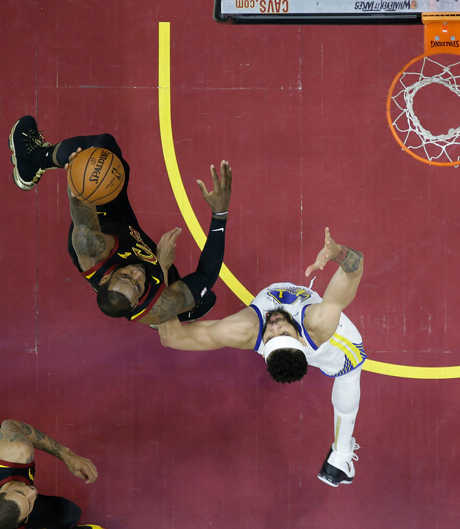 . Golden State Warriors center JaVale McGee, right, defends Cleveland Cavaliers\' LeBron James in the first half of Game 4 of basketball\'s NBA Finals, Friday, June 8, 2018, in Cleveland. (AP Photo/Carlos Osorio, Pool)
