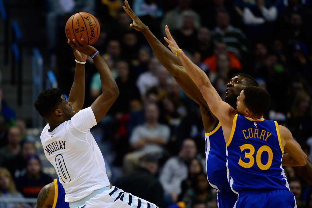 . DENVER, CO - JANUARY 13: Emmanuel Mudiay (0) of the Denver Nuggets shoots at three point shot over the defense of Stephen Curry (30) and Festus Ezeli (31) of the Golden State Warriors during the second half at the Pepsi Center on January 13, 2016 in Denver, Colorado. The Nuggets defeated the Warriors 112-110, giving the Warriors their third loss of the season. (Photo by Brent Lewis/The Denver Post)