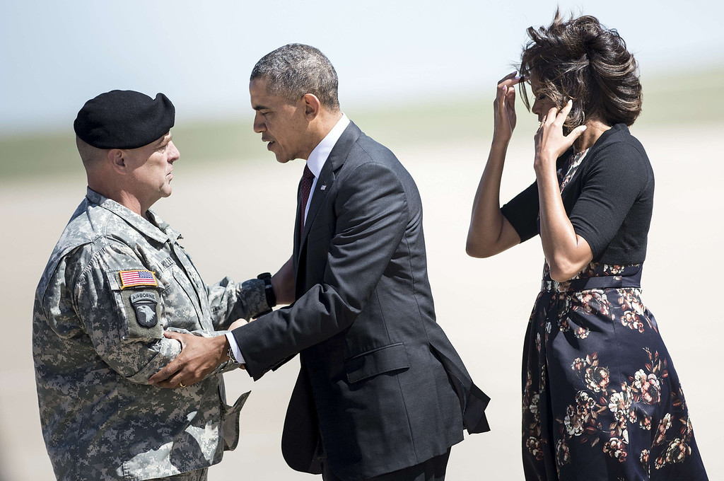 . US President Barack Obama (C) and US first lady Michelle Obama (R) are greeted Army Lt. General Mark Milley, commanding officer of Fort Hood, after arriving at Robert Gray Army Airfield on April 9, 2014 in Killeen, Texas.   AFP PHOTO/Brendan SMIALOWSKI/AFP/Getty Images
