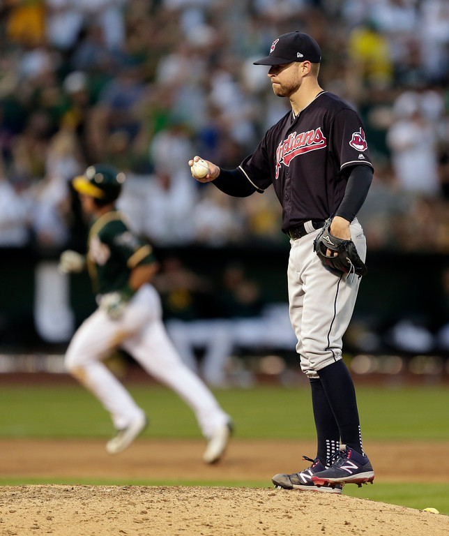 . Cleveland Indians\' Corey Kluber, right, waits for Oakland Athletics\' Matt Chapman to run the bases after hitting a home run during the eighth inning of a baseball game Saturday, July 15, 2017, in Oakland, Calif. (AP Photo/Ben Margot)