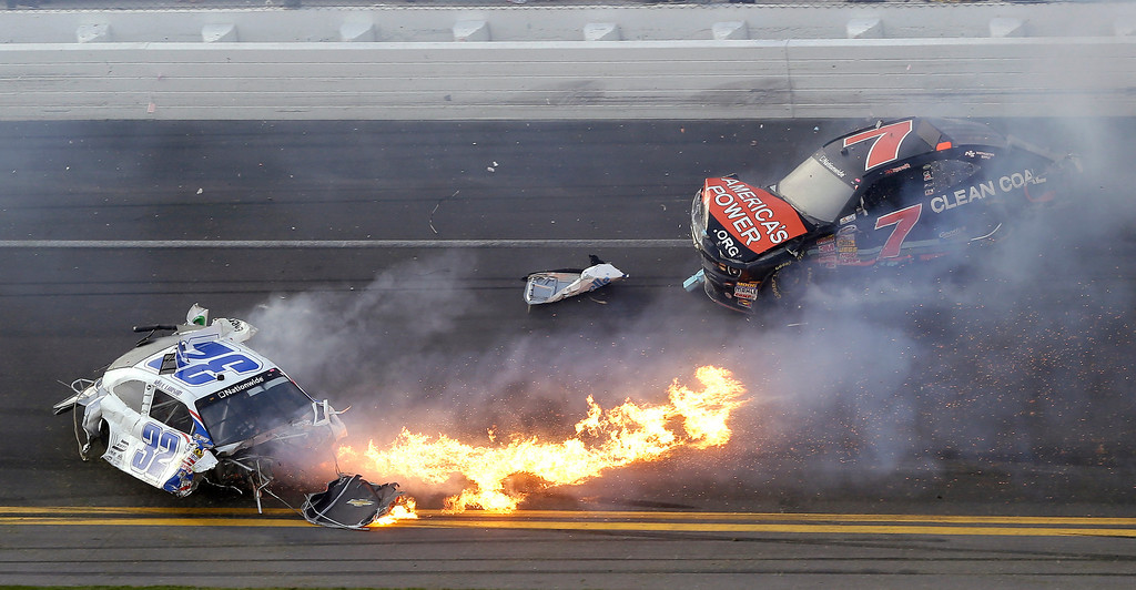 . Kyle Larson, left, slides to a stop near Regan Smith (7) after a wreck at the conclusion of the NASCAR Nationwide Series auto race Saturday, Feb. 23, 2013, at Daytona International Speedway in Daytona Beach, Fla. (AP Photo/Chris O\'Meara)
