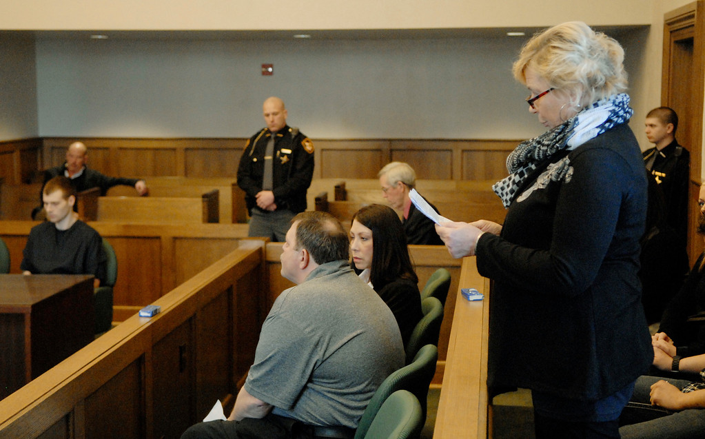 . Jeff Forman/JForman@News-Herald.com Kelly Rice, right, makes a statement in Lake County Common Pleas Court March 3 before Nathaniel Brown, left, is re-sentenced for the 2011 murder of William Andrew Fayne Putzbach.