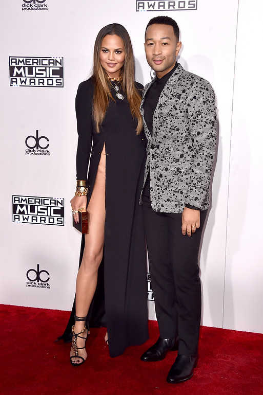 . Chrissy Teigen, left, and John Legend arrive at the American Music Awards at the Microsoft Theater on Sunday, Nov. 20, 2016, in Los Angeles. (Photo by Jordan Strauss/Invision/AP)