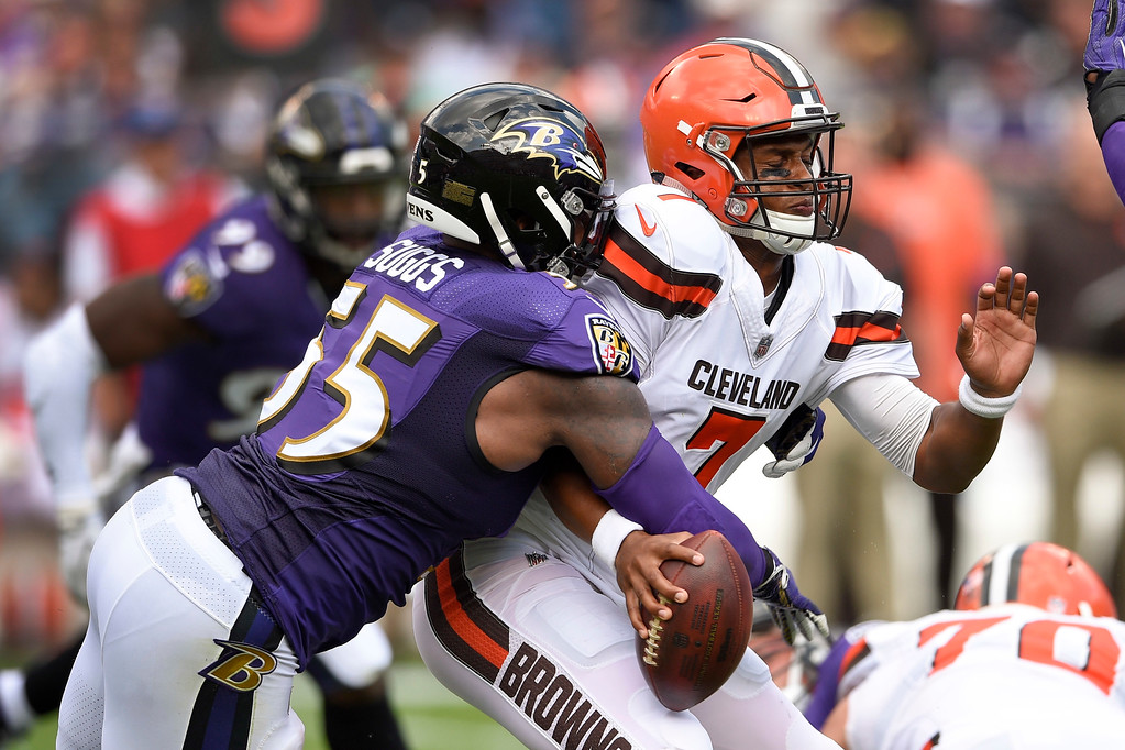 . Baltimore Ravens outside linebacker Terrell Suggs (55) strips the ball from Cleveland Browns quarterback DeShone Kizer (7) forcing a turnover during the first half of an NFL football game in Baltimore, Sunday, Sept. 17, 2017. (AP Photo/Nick Wass)