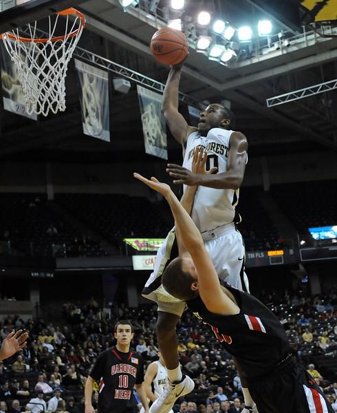 Travis McKie drive and dunk.jpg
