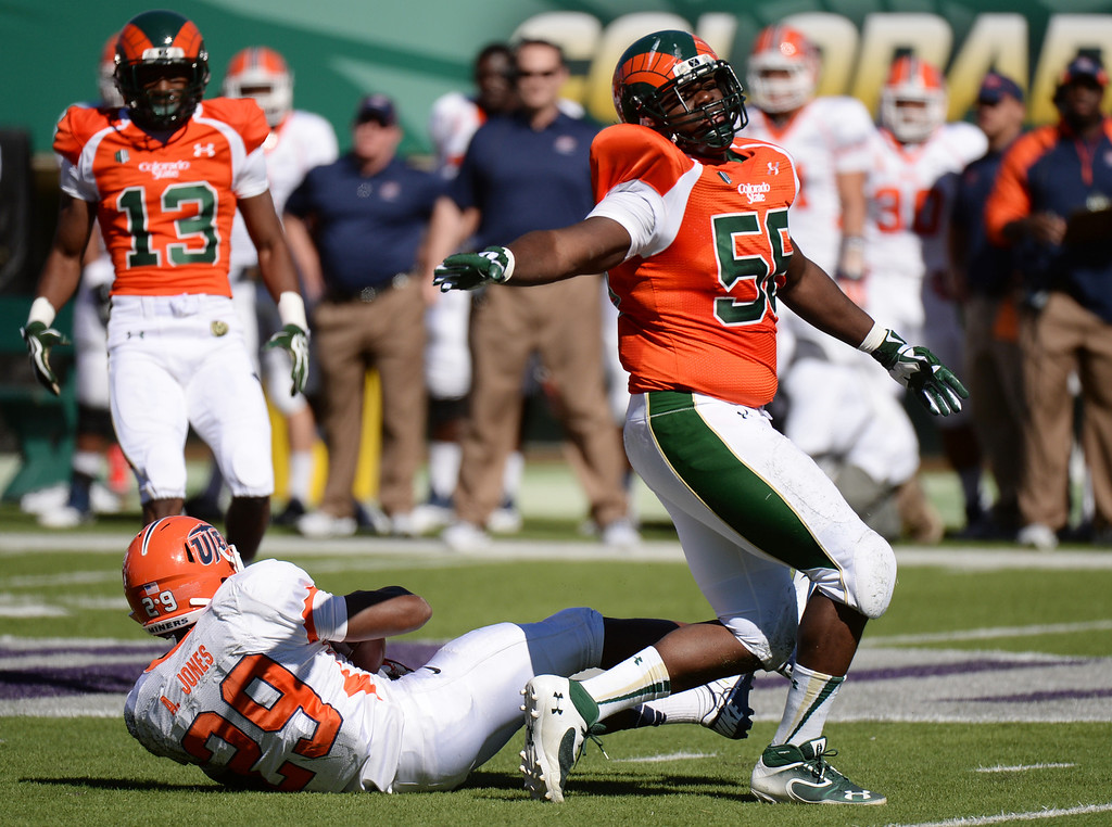 . FORT COLLINS, CO - September 28 : Shaquil Barrett of Colorado State University (56) reacts after tackling Aaron Jones of University of Texas at El Paso (29) in the 1st half of the game at Hughes Stadium. Fort Collins, Colorado. September 28, 2013. (Photo by Hyoung Chang/The Denver Post)