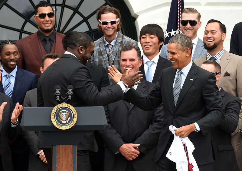 . US President Barack Obama (R) shakes hands with Red Sox Designated Hitter David Ortiz (L) during a ceremony on the South Lawn at the White House in Washington, DC, on April 1, 2014.  Obama honored the Boston Red Sox for their 2013 World Series Championship. (JEWEL SAMAD/AFP/Getty Images)