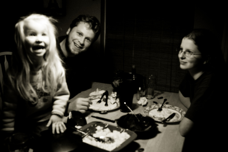A couple nights later, at dinner -with Chloe on the table. Every day is check settings day.  (Like is auto-focus still off from the last shoot...)