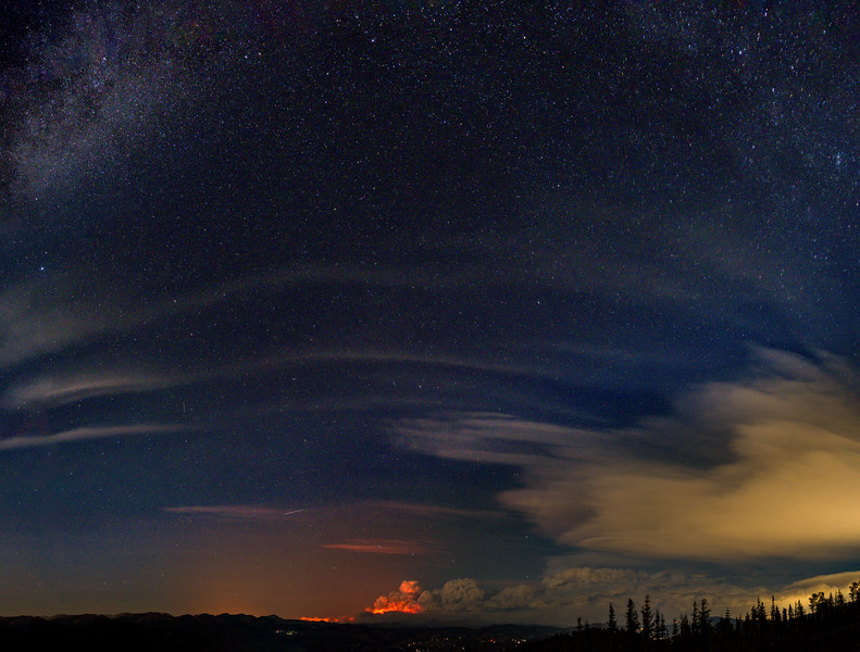 The East Troublesome fire rages on the night of October 21, 2020, under the Milky Way from Juniper Pass, Colorado.