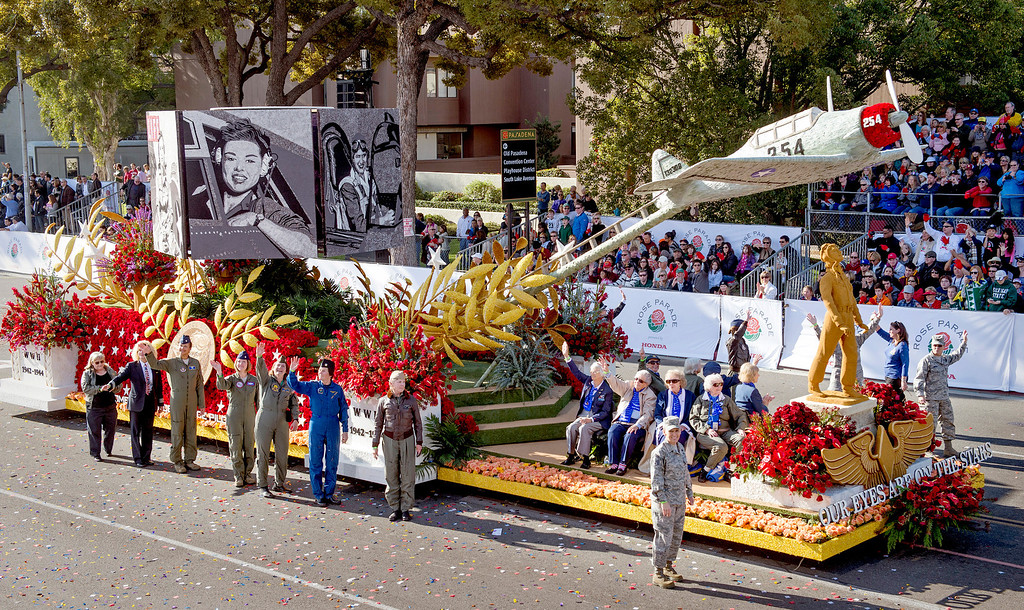 ". Eight original members of the Women Airforce Service Pilots (WASP) ride on the Wingtip to wingtip association ""Our Eyes are on the Stars\"" float during 2014 Rose Parade in Pasadena, Calif. on January 1, 2014. This float won the National award for best depiction of life in U.S.A.--past, present or future. (Staff photo by Leo Jarzomb/ Pasadena Star-News)"