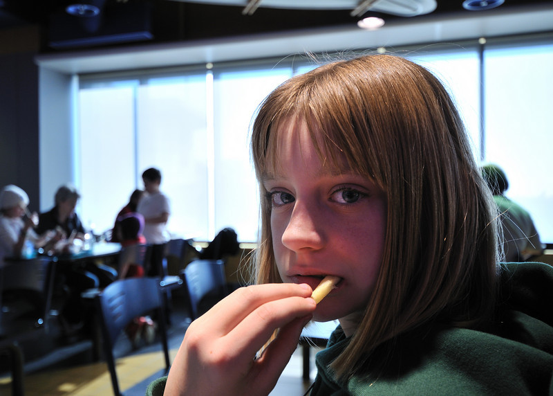 Clare munching on a french fry at the Calgary airport