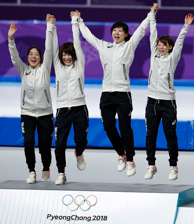 . Gold medalist team Japan Ayaka Kikuchi, Ayano Sato, Miho Takagi, and Nana Takagi, from left to right center, celebrates on the podium after the women\'s team pursuit final speedskating race at the Gangneung Oval at the 2018 Winter Olympics in Gangneung, South Korea, Wednesday, Feb. 21, 2018. (AP Photo/Vadim Ghirda)