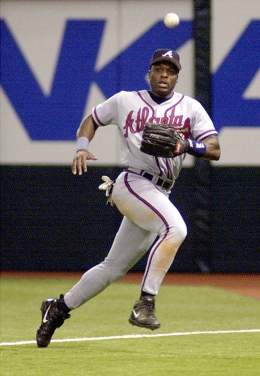 . REGGIE SANDERS -- Atlanta Braves right fielder Reggie Sanders chases down a double by Tampa Bay Devil Rays\' Vinny Castilla during the fourth inning on July 17, 2000,in St. Petersburg, Fla. (AP Photo/Steve Nesius)