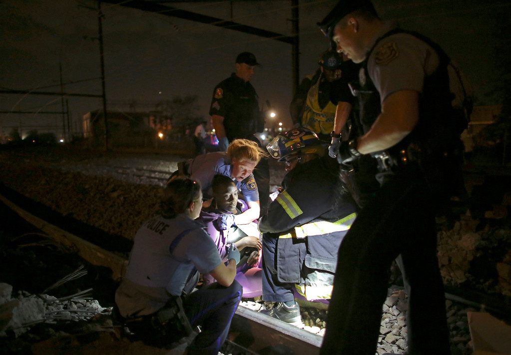 . Emergency personnel work the scene of a train wreck, Tuesday, May 12, 2015, in Philadelphia. An Amtrak train headed to New York City derailed and tipped over in Philadelphia. (AP Photo/ Joseph Kaczmarek)