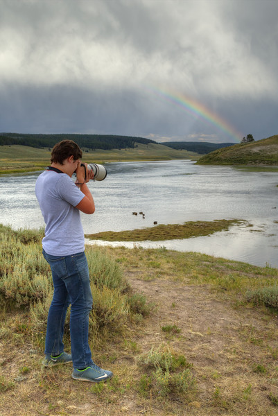 Jared tries out my big lens on the ducks in Yellowstone National Park.