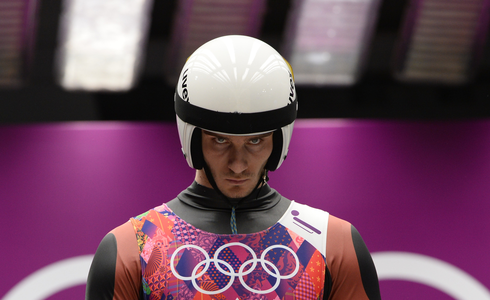 . Latvia\'s Kristaps Maurins prepares to compete during the Men\'s Luge Singles run two at the Sliding Center Sanki during the Sochi Winter Olympics on February 8, 2014.  (LIONEL BONAVENTURE/AFP/Getty Images)