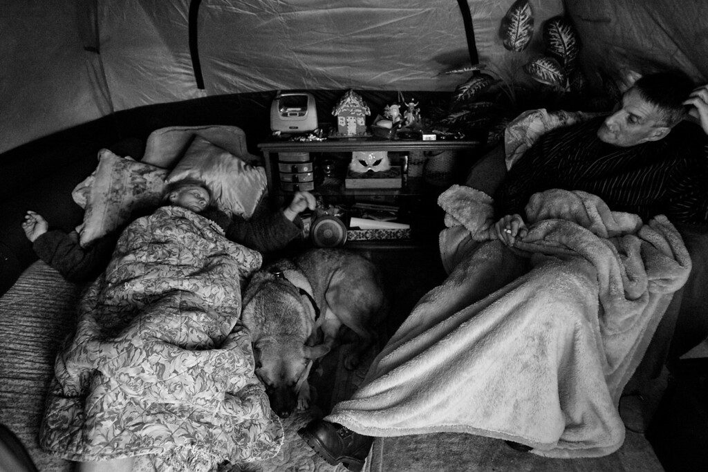 . A friend, who was just released from jail, spends the night in Dorothy\'s tent.