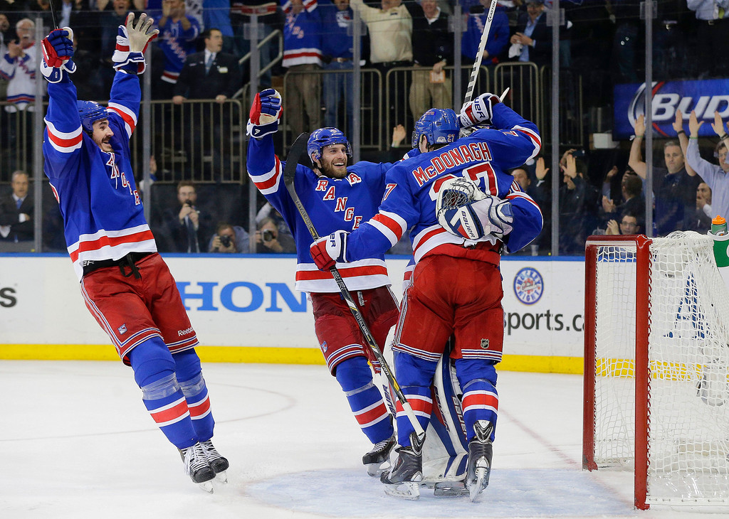 . The New York Rangers celebrate after beating the Montreal Canadiens 1-0 in Game 6 of the NHL hockey Stanley Cup playoffs Eastern Conference finals, Thursday, May 29, 2014, in New York. The Rangers advance to the Stanley Cup Finals. (AP Photo/Julie Jacobson)