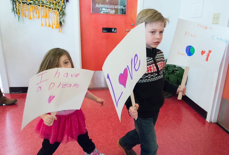 01/21/19  Wesley Bunnell | Staff  Imagine Nation held activities for children throughout the day on Monday in honor Martin Luther King Jr. Ella Kotulski, age 4, and Shane Bostwick, age 5, hold signs honoring Dr. King during their parade.