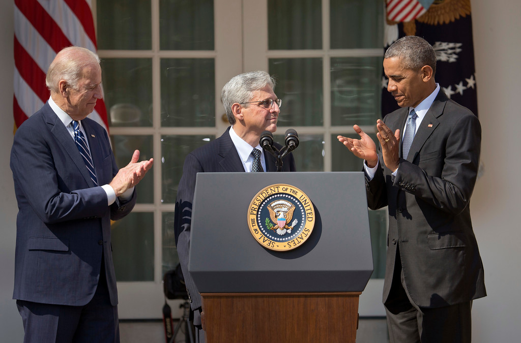 . Federal appeals court judge Merrick Garland, stands with President Barack Obama and Vice President Joe Biden as he is introduced as Obama\'s nominee for the Supreme Court during an announcement in the Rose Garden of the White House, in Washington, Wednesday, March 16, 2016.  Garland, 63, is the chief judge for the United States Court of Appeals for the District of Columbia Circuit, a court whose influence over federal policy and national security matters has made it a proving ground for potential Supreme Court justices.  (AP Photo/Pablo Martinez Monsivais)