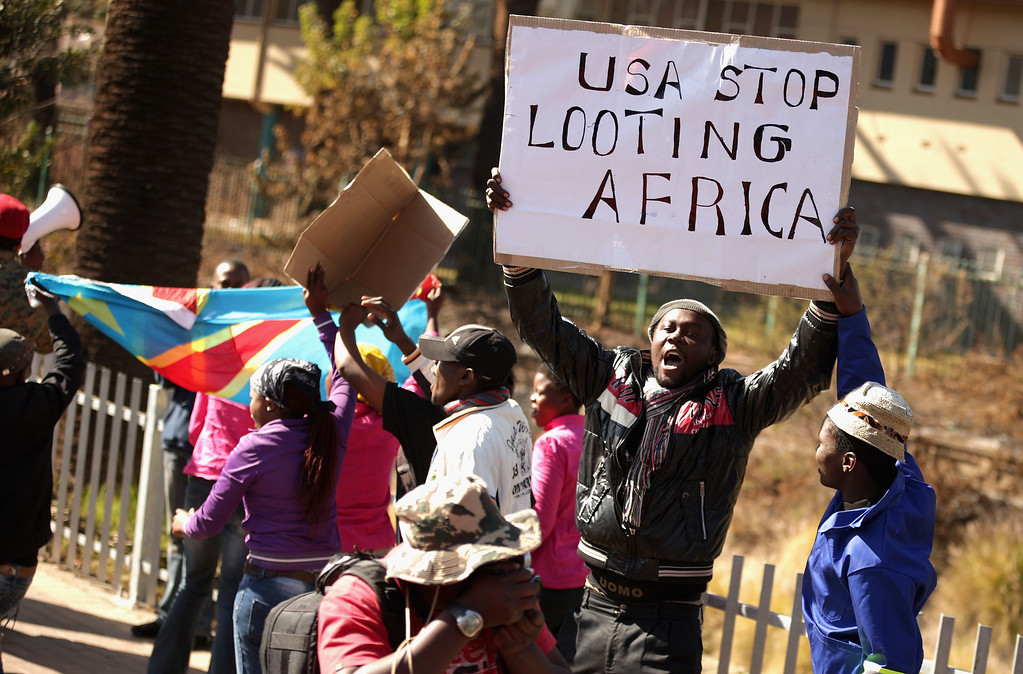 . PRETORIA, SOUTH AFRICA - JUNE 28:  Anti-American demonstrators march through the streets while protesting against the official visit of U.S. President Barack Obama June 28, 2013 in Pretoria, South Africa. Organized by the Congress of South African Trade Unions, about 800 people marched through Pretoria to voice their opposition to Obama and U.S. policy in South Africa and around the world.  (Photo by Chip Somodevilla/Getty Images)
