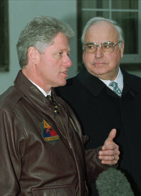 . U.S. President Bill Clinton, left, sporting a 1st.Armoured Division leather jacket and German Chancellor Helmut Kohl, right give a brief statement to the press after they meet with Bosnia-bound troops of Task Force Eagle in Smith Barracks Mess hall, Baumholder, Germany, Saturday, December 2, 1995. (AP Photo/Joe Marquette)