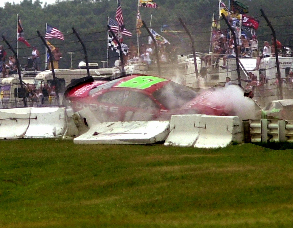 . Jeremy Mayfield crashes sideways into a wall on the second turn of Pocono International Raceway during NASCAR\'s Pennsylvania 500, Sunday, July 28, 2002, in Long Pond, Pa. Mayfield was uninjured in the crash. (AP Photo/Tom Kelly)