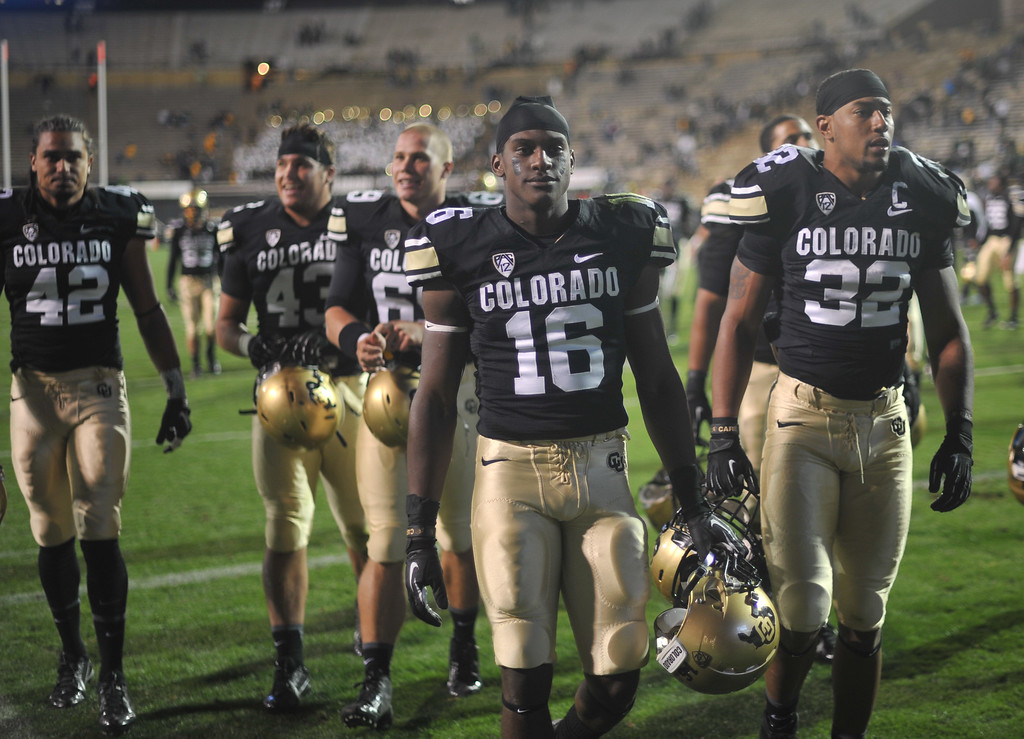 . Jeffrey Hall of University of Colorado (16) and the team leave the field after losing the game against University of Oregon at Folsom Field. Boulder, Colorado. October 5, 2013. Oregon won 57-16. (Photo by Hyoung Chang/The Denver Post)