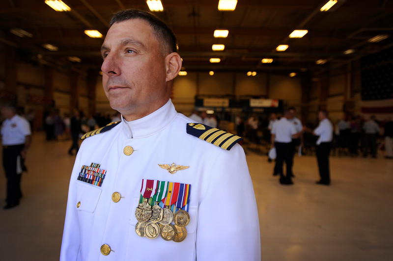Coast Guard Capt. Michael Mullen stands for a photo after he assumed command of Sector North Bend from Capt. Michael Trimpert during the Changing of the Command ceremony held at the Coast Guard station in North Bend, Ore. on Friday, July 21, 2017.