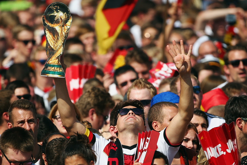 . Fans enjoy the atmosphere as they wait for the players during the German team victory ceremony July 15, 2014 in Berlin, Germany. Germany won the 2014 FIFA World Cup Brazil match against Argentina in Rio de Janeiro on July 13.  (Photo by Alex Grimm/Bongarts/Getty Images)