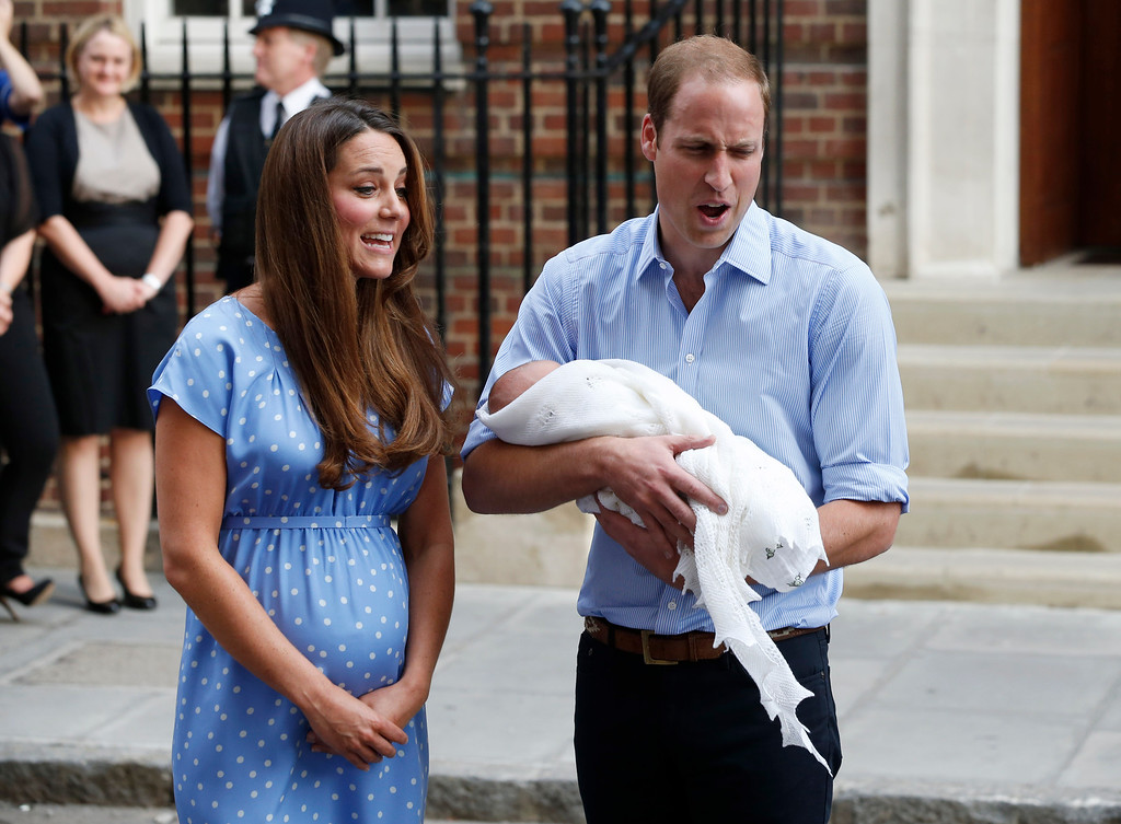 . Britain\'s Prince William and Kate, Duchess of Cambridge hold the Prince of Cambridge, Tuesday July 23, 2013, as they pose for photographers outside St. Mary\'s Hospital exclusive Lindo Wing in London where the Duchess gave birth on Monday July 22. The Royal couple are expected to head to Londonís Kensington Palace from the hospital with their newly born son, the third in line to the British throne.  (AP Photo/Lefteris Pitarakis)