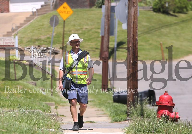 USPS mail carrier Ryan Weyandt walks his route on Mercer Road in Butler Thursday. Seb Foltz/Butler Eagle