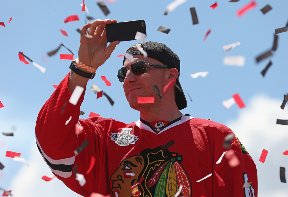 . Marian Hossa #81 of the Chicago Blackhawks takes video during the Chicago Blackhawks Victory Parade and Rally on June 28, 2013 in Chicago, Illinois. (Photo by Jonathan Daniel/Getty Images)