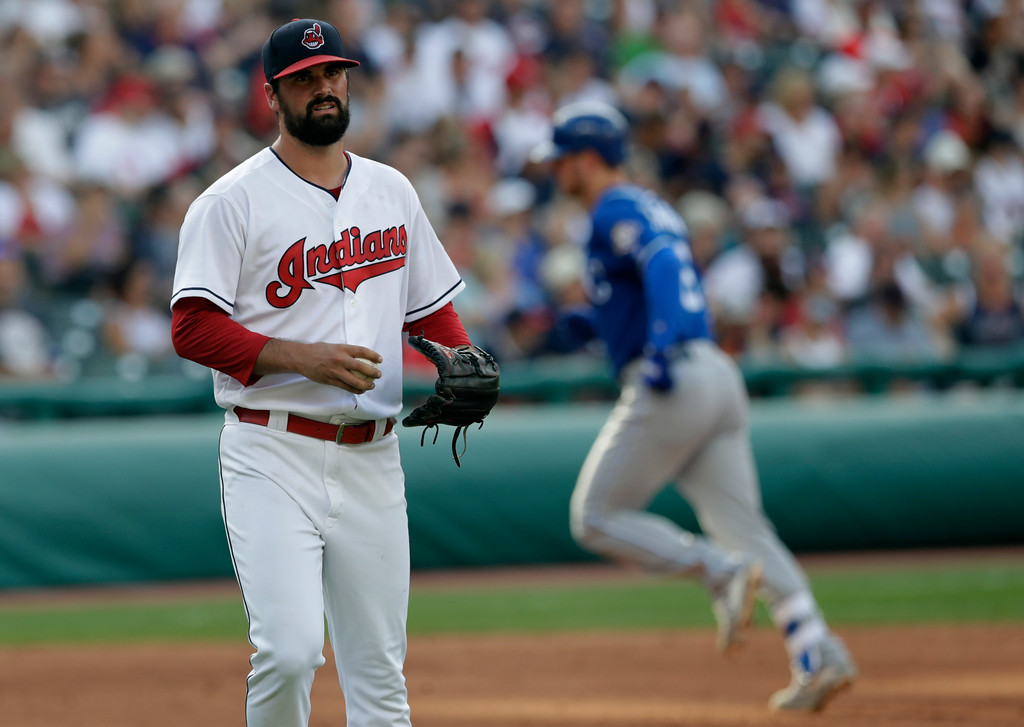 . Cleveland Indians starting pitcher Adam Plutko, left waits for Kansas City Royals\' Ryan O\'Hearn to run the bases after O\'Hearn hit a two-run home run in the sixth inning of a baseball game, Monday, Sept. 3, 2018, in Cleveland. (AP Photo/Tony Dejak)