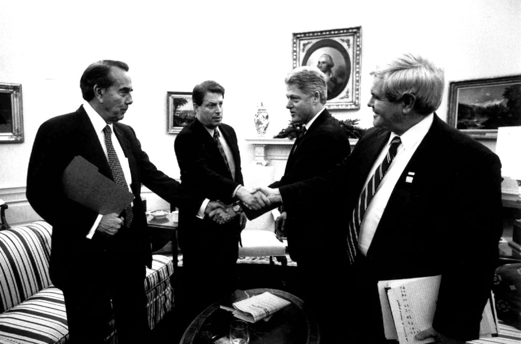 """. President Clinton shakes hands with Senate Majority Leader Bob Dole of Kansas and Vice President Gore shakes hands with House Speaker Newt Gingrich of Georgia during their Oval Office meeting Tuesday Dec. 19, 1995 to discuss the federal budget impasse. Budget talks collapsed Wednesday after President Clinton scuttled an Oval office meeting with Republican leaders and accused \""""the most extreme\"""" House Republicans of reneging on a deal that could have ended the government\'s partial shutdown. (AP Photo/White House)"""