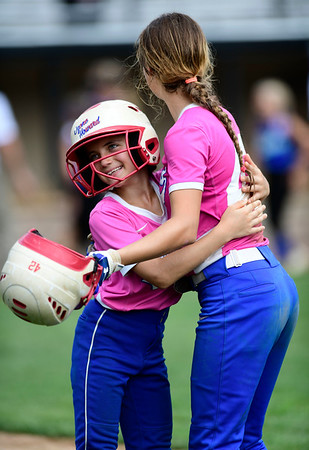 7/20/2019 Mike Orazzi | Staff New Yorks Kimmy Piazza (11) and Melanie Snyder (42) celebrate a win during Little League softball with Maryland at Breen Field in Bristol on Saturday.
