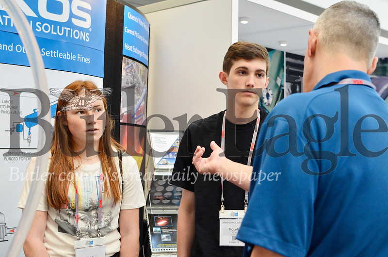 Ellie Coffield, 16, a Mars High School sophomore, and Nolan Kush, 16, a junior at Mars High School listen to an exhibitor at the 2019 Association for Iron and Steel Technology Conference in Pittsburgh. Tanner Cole/Butler Eagle