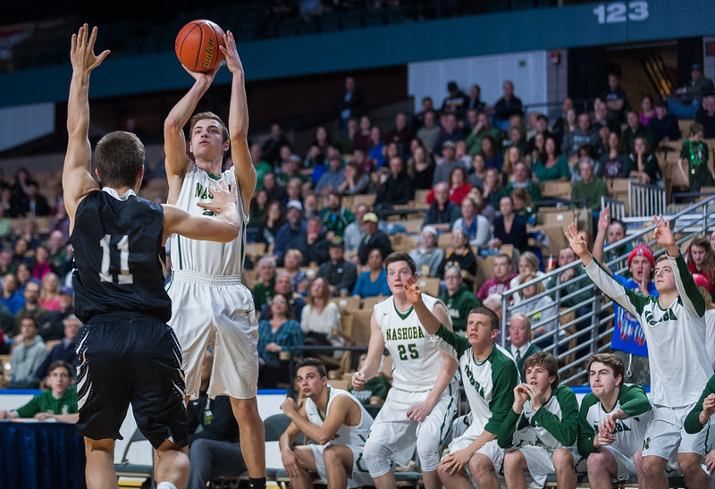 . Nashoba\'s Andrew Fish goes up for a 3 pointer in the 4th quarter as the bench reacts. SENTINE&ENTERPRISE/ Jim Marabello