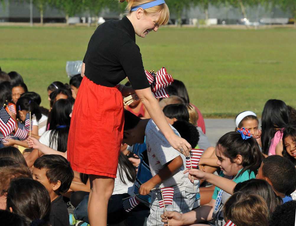 . (John Valenzuela/Staff Photographer) Jessica Neilson hands-out American flags at Mission Elementary in Redlands during the schools Patriot�s Day celebration, marking the 12th Anniversary of the 9/11 attacks, Wednesday, September 11, 2013. Kafader discussed the tragic events that happen on Sept. 11, 2001, when nearly 3000 people were killed during the terrorist attacks 12 years ago.